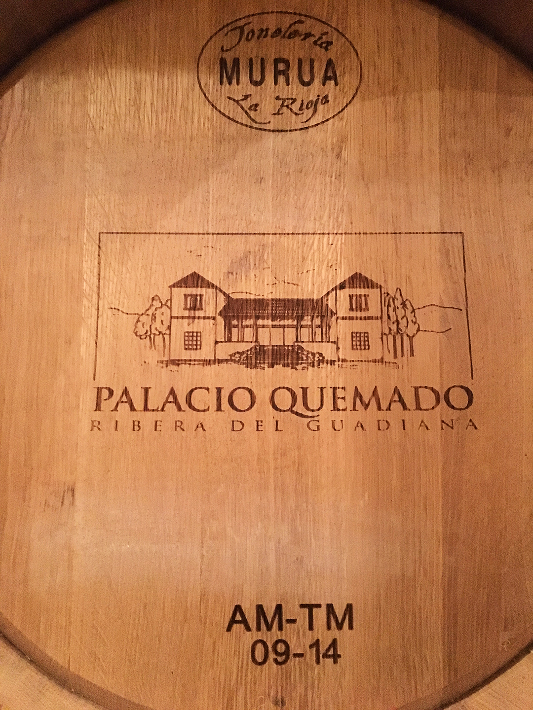 barrel end bearing the name and image of Palacio Quemado