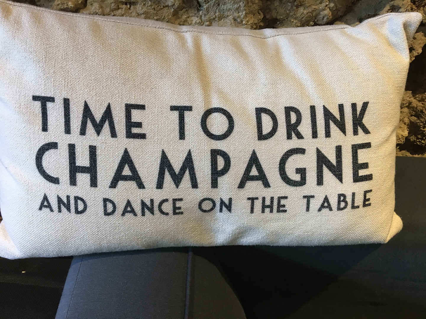 Rough fabric pillow with the text TIME TO DRINK CHAMPAGNE AND DANCE ON THE TABLE