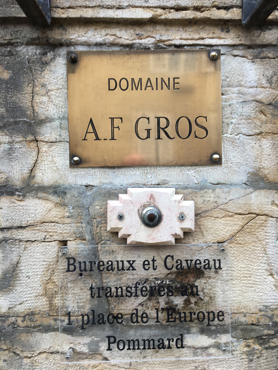 Brass nameplate DOMAINE A.F. GROS on a stone wall