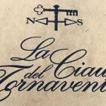 Logo in script typeface for La Ciau del Tornavento