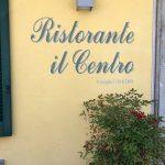 Sign on wall in script: Ristorante il Centro
