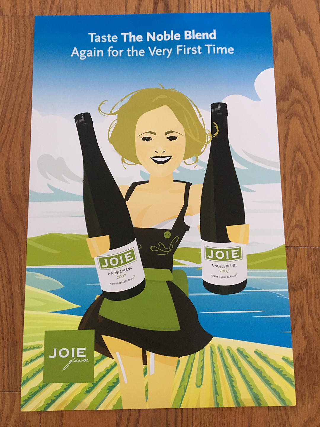 Cartoon illustration of a farm girl holding out two bottles of JOIE wine; vineyards, lakes, and mountains are in the background